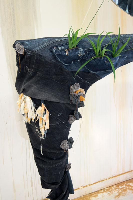 Peeling denim mantelpiece art installation by Tarmi Clarke